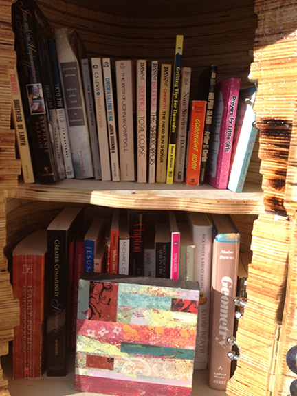 Not only can you check out a book art is available to check out too!